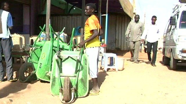 Wheelbarrow user in Khartoum