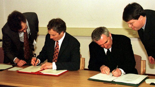 British Prime Minister Tony Blair and Irish Taoiseach Bertie Ahern sign the Good Friday Agreement