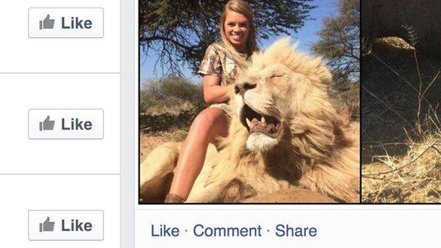 Kendall Jones holding a dead lion