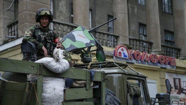 Ukrainian soldier on vehicle in Sloviansk