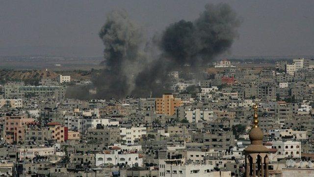 Smoke billows from buildings following an Israeli air strike on Gaza City