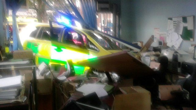 Rapid response vehicles crashes through insurers window