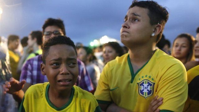 Brazil football fans cry as they watch their team