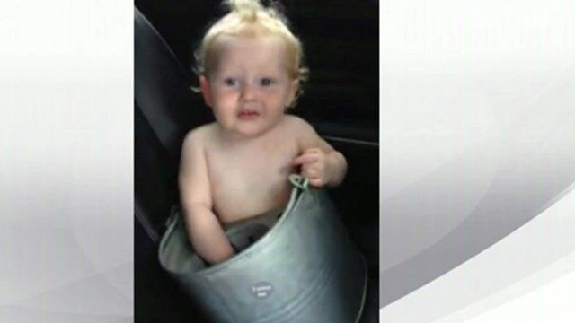 A baby in a bucket