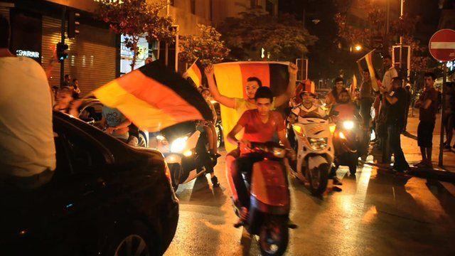 Fans waving German flags