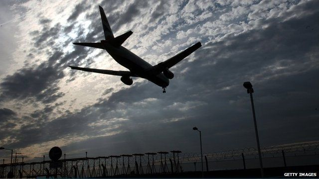 A plane comes into land at Heathrow Airport