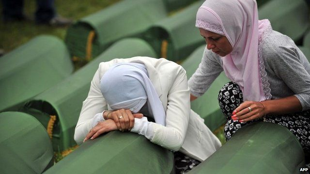 Bosnian Muslim woman cries by the coffin of a relative