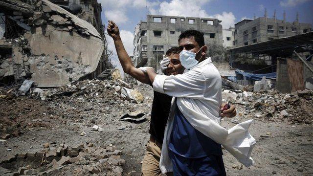 A medic helps a Palestinian in the Shejaiya neighbourhood