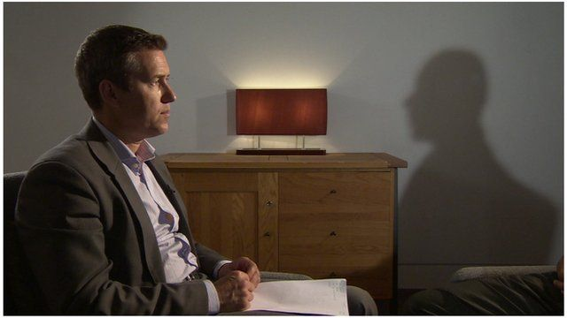 BBC London reporter Guy Smith with victim in shadow