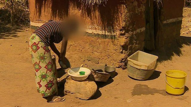 teenager washes pots