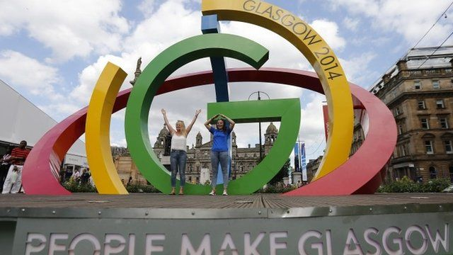 People posing on a Commonwealth Games sculpture