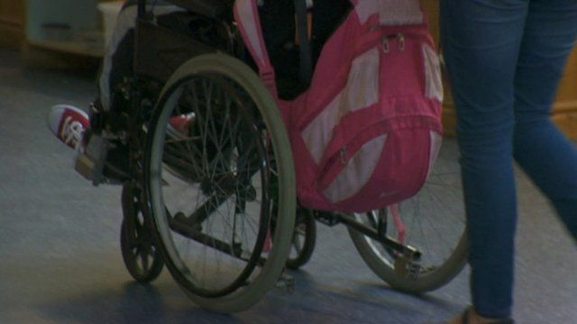 A wheelchair being pushed