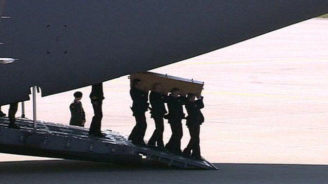 Flight bringing flight MH17 crash remains to Amsterdam