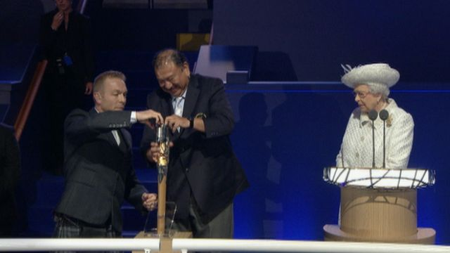 Sir Chris Hoy opens the Queen's Baton during the opening ceremony