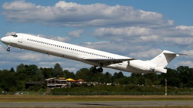 The Swiftair MD-83 airplane taking off from Hamburg airport. 15 June 2014