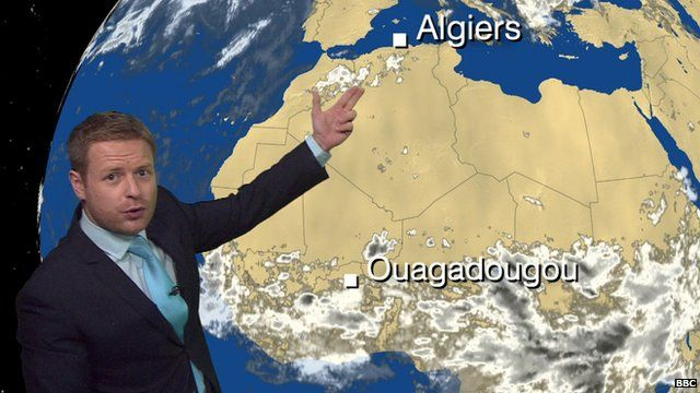 BBC Weather's Tomasz Schafernaker in front of a weather satellite image of Africa