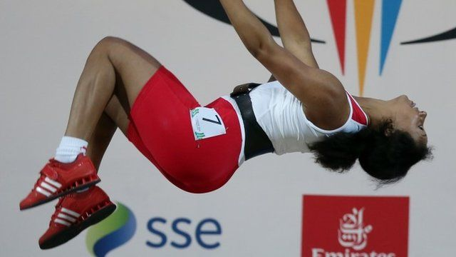 Weightlifter Zoe Smith celebrates gold with back flip