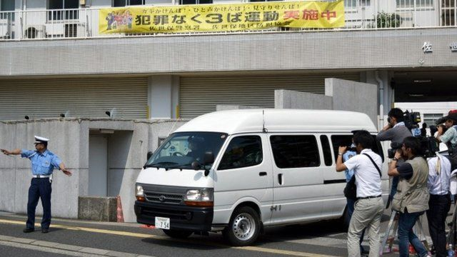 "A van carrying a 15-year-old high schoolgirl, who was arrested on suspicion of killing a school friend at her home, leaves a police station for the prosecutor""s office in Sasebo in Nagasaki prefecture,"