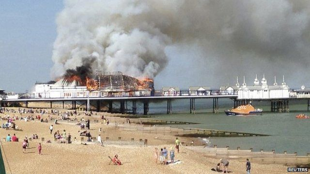 Fire and smoke engulf the pier