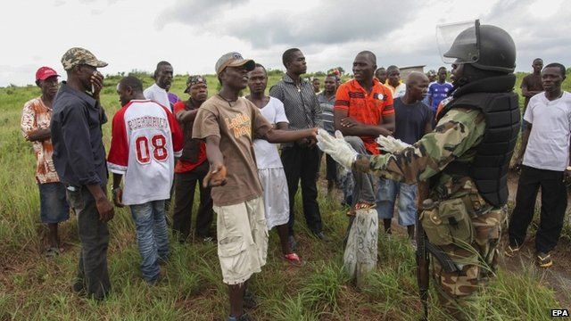 Liberians stage a protest against using their community to bury dead victims of the Ebola virus
