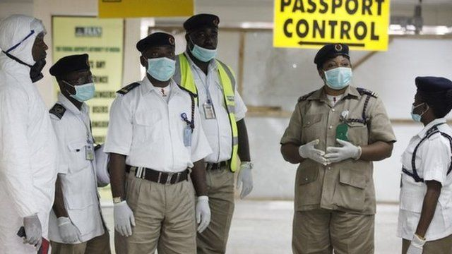 Nigeria health officials wait to screen passengers at the arrival hall of Murtala Muhammed International Airport in Lagos, Nigeria, Monday, 4 August 2014