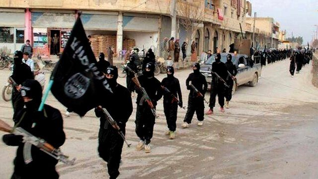 Fighters from the Islamic State of Iraq and the Levant (ISIL) marching in Raqqa, Syria, Jan 2014