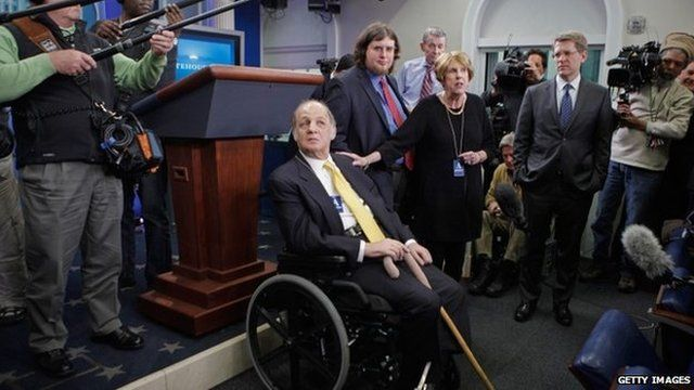 Former White House Press Secretary James Brady visit the press briefing room that bears his name in the West Wing of the White House with current Press Secretary Jay Carney (3rd R) 30 March 2011 in Washington, DC.