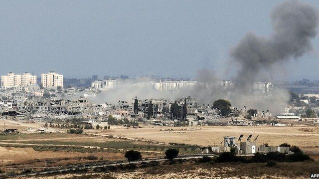 Air strike on Gaza seen from the Israeli side of the border (10 August)