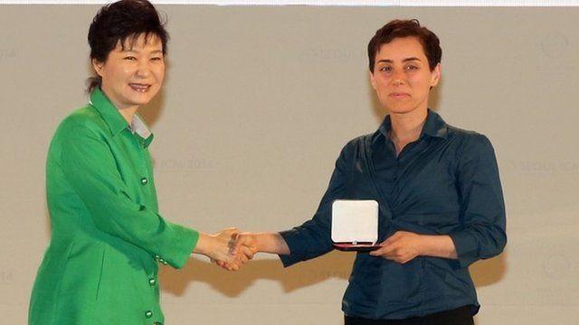 South Korean President Park Geun-Hye (L) giving the prize to Maryam Mirzakhani (R)