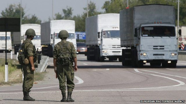 Military personnel and Russian humanitarian convoy.