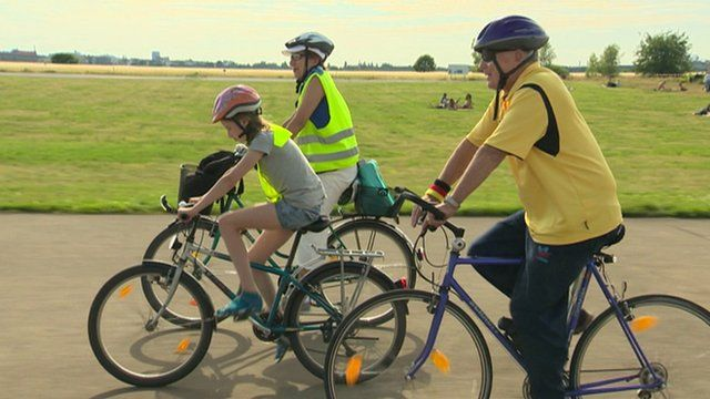 German mother and daughter cycling with 'adopted' grandfather