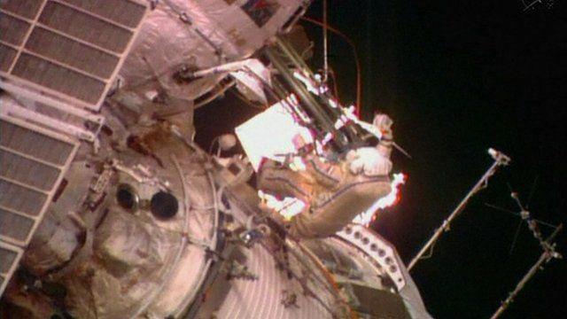 Cosmonaut embarks on spacewalk
