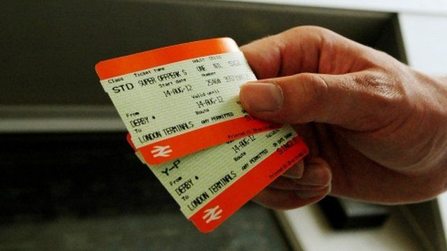 Person holding two rail tickets