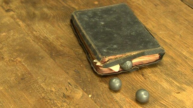 George Vinall's bible and three three shrapnel bullets