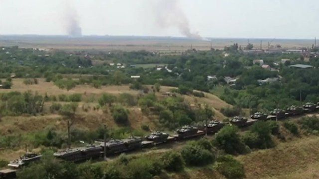 A still from unverified amateur footage show Russian armoured vehicles on railway flat cars, heading in the direction of Ukraine