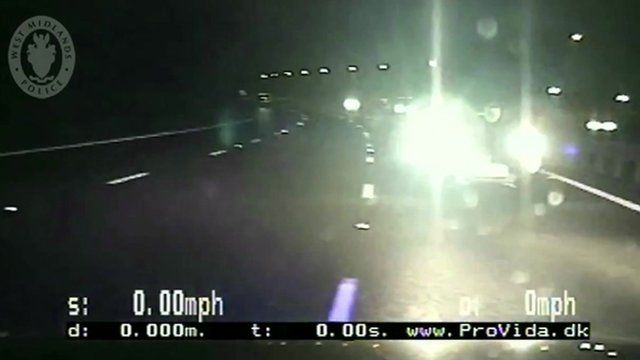 Still from dashboard camera shows car approaching police vehicle head on