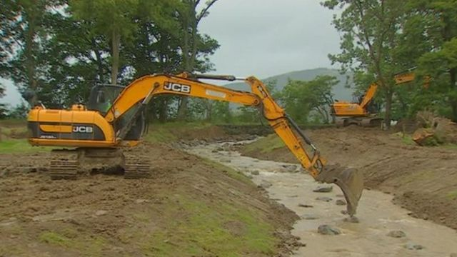 Diggers at Whit Beck, in the Lake District