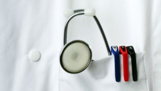 Doctor's coat pocket with stethoscope and pens
