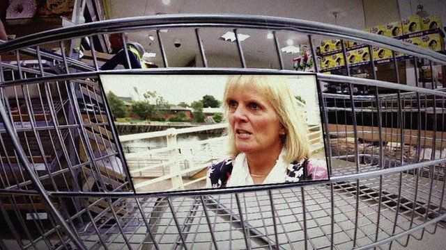 Image of woman imposed onto shopping trolley