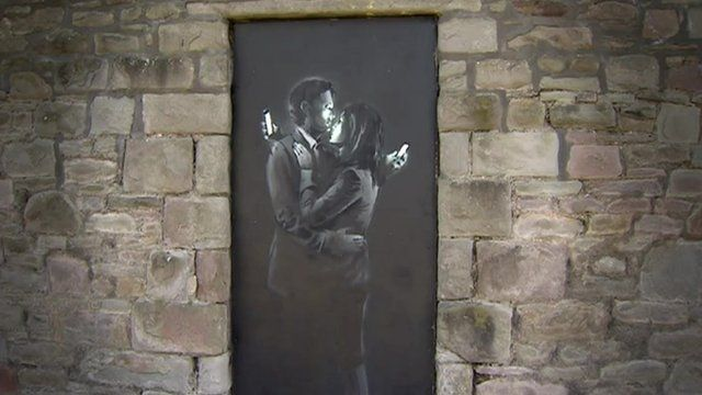 Banksy's Mobile Lovers piece,