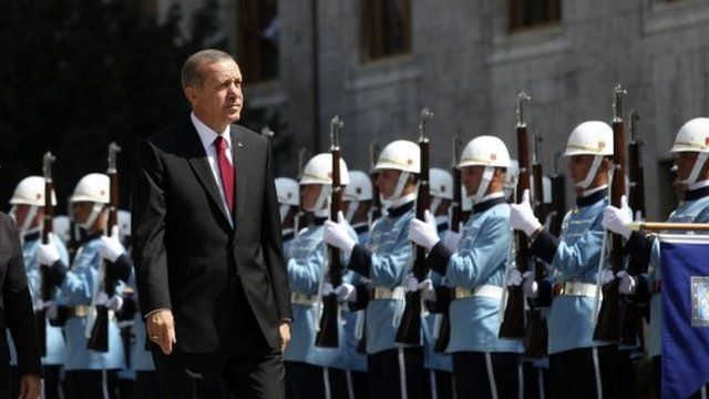 Turkey's new President RecepTayyip Erdogan attends a swearing in ceremony in front of the parliament building in Ankara