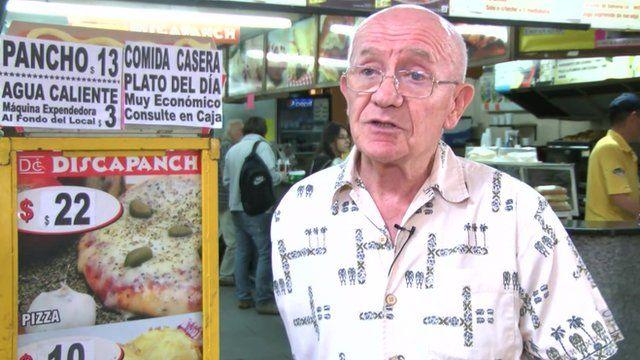 """The owner of """"Discapanch"""" at the entrance of the restaurant"""