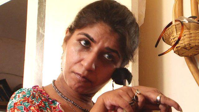 Divya Arora doing her makeup