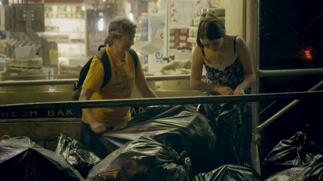 Janet Kalish and another dumpster diver looking through trash