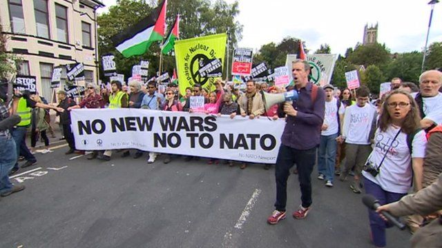 anti nato protestors march through Newport