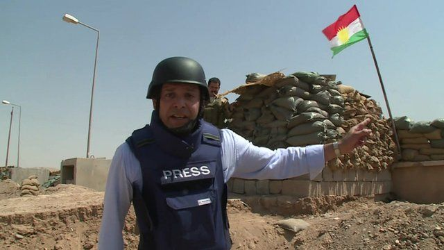 BBC reporter Reda al Mawy reporting from outside the Iraqi village of Amerli