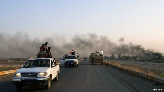 Iraqi Shiite militia fighters in their vehicles after breaking the siege of Amerli by Islamic State militants, 1 September 2014