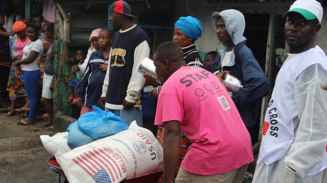 Liberian red cross distributes food provided by USAID in Monrovia
