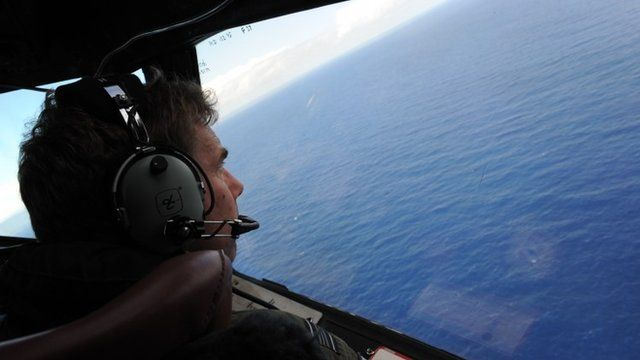 The Royal New Zealand Air Force look for objects during the search for missing Malaysia Airlines flight MH370,