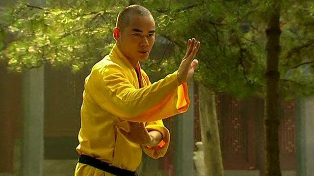 Buddhist monk at Shaolin Temple in China doing Kung Fu
